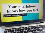 """Computer showing presentation """"Your smartphone knows how you feel"""""""