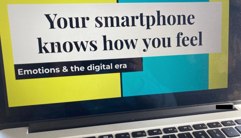 "Computer showing presentation ""Your smartphone knows how you feel"""